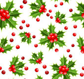 Seamless background with Christmas holly. Stock Image