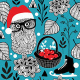 Seamless background with Christmas owls and red berries. Royalty Free Stock Photography
