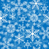 Seamless background with Christmas snowflakes Stock Photos