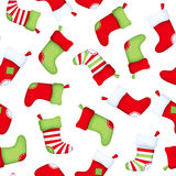 Seamless background with Christmas socks. Vector illustration. Royalty Free Stock Photo