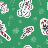 Seamless background with Christmas sweets. On green, with hand drawn elements Stock Photos