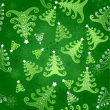 Seamless background with Christmas trees. Green seamless background with snowflakes and green stylized Christmas trees decorated with white stars Royalty Free Stock Image