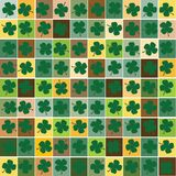 Seamless background with clovers Royalty Free Stock Photo