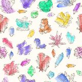 Seamless background with colored doodle crystals on white background.  Royalty Free Stock Photo