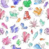 Seamless background with colored doodle crystals on white background.  Royalty Free Stock Photos