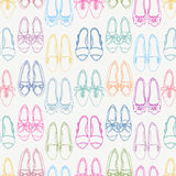 Seamless background with colored shoes Royalty Free Stock Images