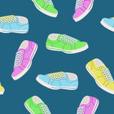 Seamless background with colored trainers Royalty Free Stock Image