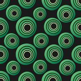 Seamless background of concentric circles in neon green colors on black. Retro pattern, inspired by the 60s royalty free illustration