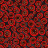 Seamless background of concentric circles in neon red colors on black. Retro pattern, inspired by the 60s vector illustration
