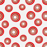 Seamless background of concentric circles in neon red colors on white. Retro pattern, inspired by the 60s stock illustration