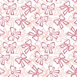 Seamless background, contours bows. Abstract holiday seamless pattern with red and pink outline bows on white background Royalty Free Stock Photography