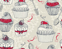 Seamless background with cupcakes Stock Image