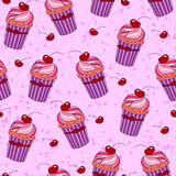 Seamless background with cupcakes Stock Photos