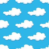 Seamless background with cute cartoon clouds Stock Photo