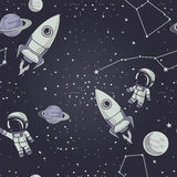 Seamless background with cute doodle astronauts, planets, rockets and stars Stock Images