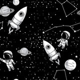 Seamless background with cute doodle astronauts, planets, rockets and stars Royalty Free Stock Image