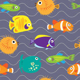Seamless background with cute marine fish on the waves Stock Photo