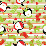 Seamless background with cute penguin and Xmas ornaments on stripes background  suitable for children Xmas wallpaper, and scrap pa Royalty Free Stock Images