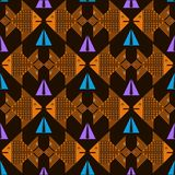 Seamless background with decorative image of fish and triangles. Dark brown seamless background with decorative orange fish and decorative light blue and lilac Royalty Free Stock Image