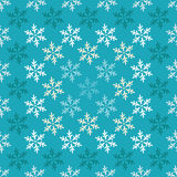 Seamless background with decorative snowflakes Stock Photo