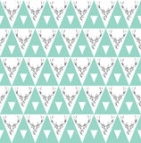 Seamless background with deer heads. ethnic ornament Stock Photos