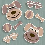 Seamless background with dogs, paws and bones Royalty Free Stock Photography