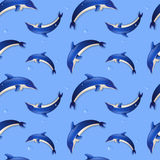 Seamless background with dolphins. Vector illustration. Royalty Free Stock Photo