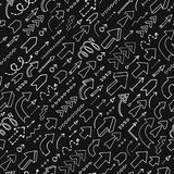 Seamless background of doodle arrows Stock Images