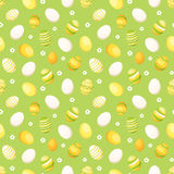 Seamless background with Easter eggs. Vector illus. Vector seamless background with white, yellow and orange Easter eggs on green Royalty Free Stock Photography