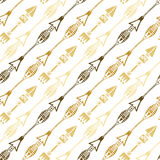 Seamless background of ethnic arrow in gold colors. Hand drawn arrows vector pattern. Stock Photos