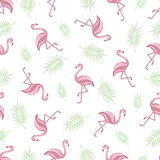 Seamless background with flamingos. pattern. Flamingo and palm branch on a white background. Vector. Royalty Free Stock Image