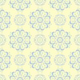 Seamless background with floral pattern. Beige background with light blue and green flower elements. For wallpapers, textile and fabrics Stock Photography