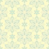 Seamless background with floral pattern. Beige background with light blue and green flower elements. For wallpapers, textile and fabrics Royalty Free Stock Photo