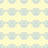 Seamless background with floral pattern. Beige background with light blue and green flower elements. For wallpapers, textile and fabrics Stock Image