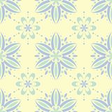 Seamless background with floral pattern. Beige background with light blue and green flower elements. For wallpapers, textile and fabrics Stock Images
