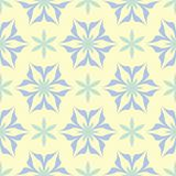 Seamless background with floral pattern. Beige background with light blue and green flower elements. For wallpapers, textile and fabrics Stock Photos