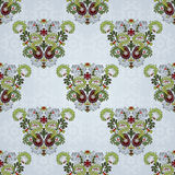 Seamless background with floral symmetrical elements. Royalty Free Stock Photography