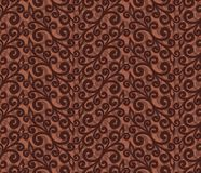 Seamless background with a flower pattern. A seamless brown background with a flower pattern Stock Photography