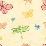Seamless background with flowers, butterflies, dragonflies and ladybugs Royalty Free Stock Image