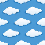 Seamless background with fluffy clouds. Seamless background pattern of white fluffy clouds in blue sky suitable for children's wallpapers, tiles, textile and Royalty Free Stock Photo