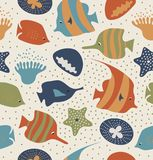 Seamless background with funny fishes, jellyfishes. Decorative marine texture. Pattern with sea creatures, corals. Stock Photo