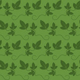 Seamless background with green leaves Stock Photos