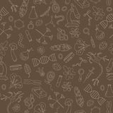 Seamless illustration with hand drawn icons on the theme of biology,beige outline on a brown background. Seamless background with hand drawn icons on the theme Royalty Free Stock Images