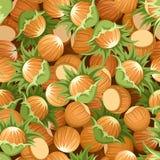 Seamless background with hazelnuts. Seamless background with beige and brown hazelnuts Stock Photo