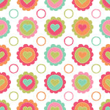 Seamless background with hearts and flowers Stock Images