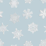 Seamless background of home-made paper snowflakes. Royalty Free Stock Photo