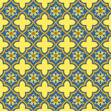 Seamless background image of oriental golden blue curve cross flower Royalty Free Stock Photography