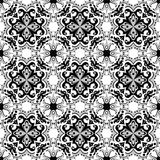 Seamless background image of vintage black gray vintage round spiral kaleidoscope pattern. Stock Photo