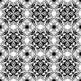 Seamless background image of vintage black gray vintage round spiral kaleidoscope pattern. Stock Photo