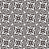 Seamless background image of vintage black white curve spiral kaleidoscope pattern. Stock Photos